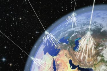 artist's view of cosmic rays hitting the earth